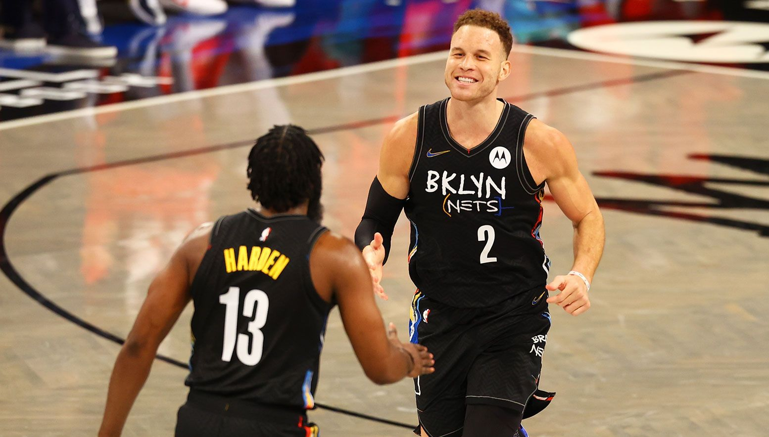 Blake Griffin smiling with James Harden