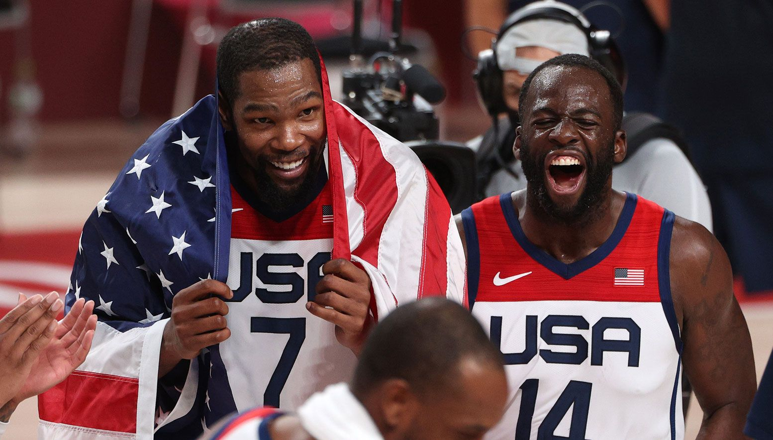 Draymond Green and Kevin Durant celebrating with Team USA